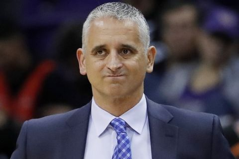 FILE - In this Jan. 24, 2019, file photo, Phoenix Suns head coach Igor Kokoskov watches during the second half of an NBA basketball game against the Portland Trail Blazers. The Suns say they have fired Kokoskov after one season. (AP Photo/Matt York, File)