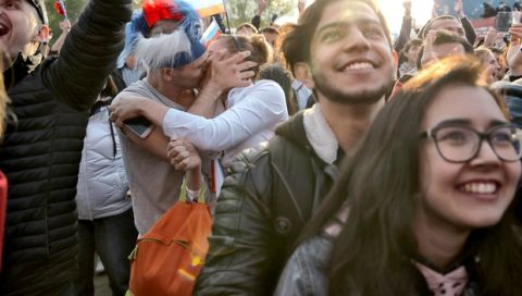 A couple kiss as fans celebrate after Russia scored the first goal during the opening match of the 2018 soccer World Cup, between Russia and Saudi Arabia, in the fan zone in Yekaterinburg, Russia, Thursday, June 14, 2018. (AP Photo/Vadim Ghirda)