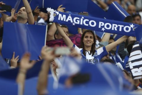 Porto fans cheer on the stands during the Portuguese league soccer match between FC Porto and Feirense at the Dragao stadium in Porto, Portugal, Sunday, May 6, 2018. Porto clinched the league title Saturday night, two rounds before the end, when Benfica and Sporting CP tied 0-0 in their Lisbon derby. (AP Photo/Luis Vieira)