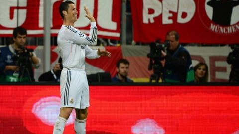 Real Madrid's Portuguese forward Cristiano Ronaldo celebrates scoring the 0-3 during the UEFA Champions League second-leg semi-final football match FC Bayern Munich vs Real Madrid CF in Munich, southern Germany, on April 29, 2014. AFP PHOTO / JOHN MACDOUGALL        (Photo credit should read JOHN MACDOUGALL/AFP/Getty Images)