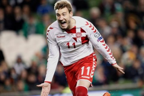 FILE - In this Tuesday, Nov. 14, 2017 filer, Denmark's Nicklas Bendtner celebrates after scoring his side's fifth goal during the World Cup qualifying play off second leg soccer match between Ireland and Denmark at the Aviva Stadium in Dublin, Ireland. (AP Photo/Peter Morrison, File)