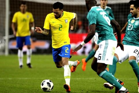 Brazil's Dani Alves runs with the ball during the international friendly soccer match between Germany and Brazil in Berlin, Germany, Tuesday, March 27, 2018. (AP Photo/Markus Schreiber)