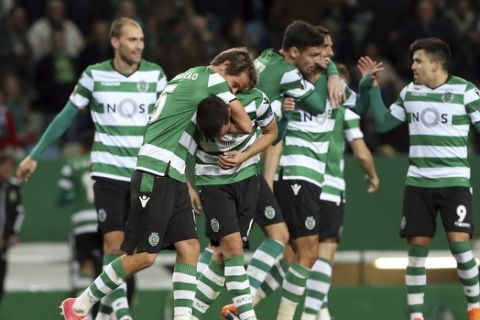 Sporting players celebrate after Bruno Fernandes, third left, scored his side's second goal during the Europa League round of 32 second leg soccer match between Sporting CP and Astana at the Alvalade stadium in Lisbon, Thursday Feb. 22, 2018. (AP Photo/Armando Franca)