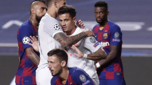 Bayern's Philippe Coutinho, center, celebrates after scoring his sides seventh goal during the Champions League quarterfinal match between FC Barcelona and Bayern Munich at the Luz stadium in Lisbon, Portugal, Friday, Aug. 14, 2020. (AP Photo/Manu Fernandez/Pool)