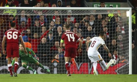 Roma's Diego Perotti, right, scores his side's second goal from the penalty spot during the Champions League semifinal, first leg, soccer match between Liverpool and AS Roma at Anfield Stadium, Liverpool, England, Tuesday, April 24, 2018. (AP Photo/Dave Thompson)