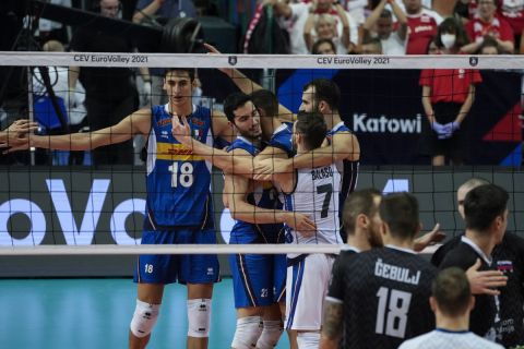 Italy players celebrate winning a point during the men's European Championship volleyball final between Slovenia and Italy, at the Spodek Arena in Katowice, Poland, Sunday, Sept. 19, 2021. (AP Photo/Czarek Sokolowski)