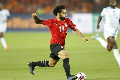 Egypt's Mohamed Salah controls the ball during the group A soccer match between Egypt and DR Congo at the Africa Cup of Nations at Cairo International Stadium in Cairo, Egypt, Wednesday, June 26, 2019. (AP Photo/Ariel Schalit)