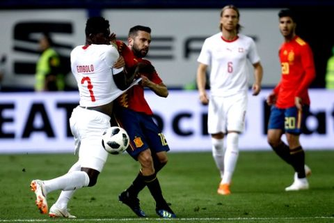 Spain's Jordi Alba, second left and Switzerland's Breel Embolo fight for the ball during the friendly soccer match between Spain and Switzerland at the Ceramica stadium in Villarreal, Spain, Sunday, June 3, 2018. (AP Photo/Alberto Saiz)