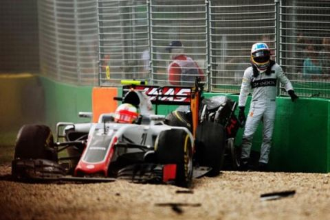 MELBOURNE, AUSTRALIA - MARCH 20:  Fernando Alonso of Spain and McLaren Honda climbs out of his car after crashing Esteban Gutierrez of Mexico,(21) Haas F1 Team Haas-Ferrari VF-16 Ferrari 059/5 turbo  during the Australian Formula One Grand Prix at Albert Park on March 20, 2016 in Melbourne, Australia.  (Photo by Peter J Fox/Getty Images)