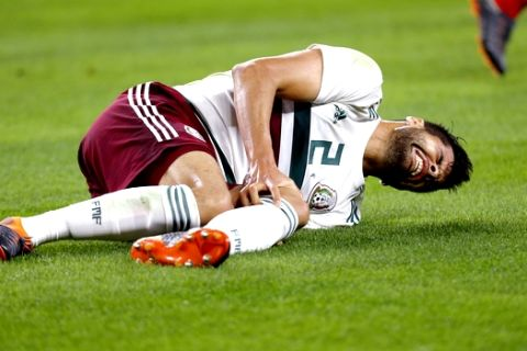 Mexico defender Nestor Araujo (2) suffers a leg injury during the first half of an international friendly soccer match against Croatia in Arlington, Texas, Tuesday, March 27, 2018. (AP Photo/Roger Steinman)