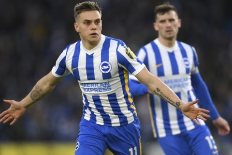 Brighton's Leandro Trossard celebrates after scoring his side's first goal during the English Premier League soccer match between Brighton & Hove Albion and Manchester City at the Amex stadium in Brighton, England, Tuesday, May 18, 2021. (Mike Hewitt, Pool via AP)