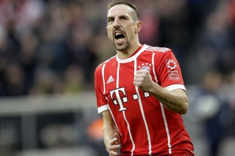Bayern's Franck Ribery celebrates after scoring before his goal is disallowed during the German Bundesliga soccer match between FC Bayern Munich and Borussia Dortmund in Munich, Germany, Saturday, March 31, 2018. (AP Photo/Matthias Schrader)
