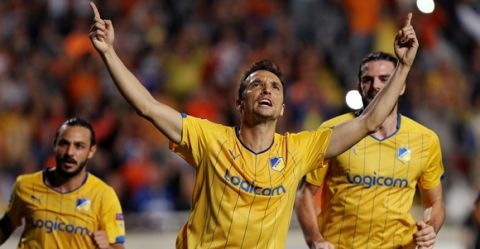 APOEL Nicosia's Gustavo Manduca celebrates after scoring a goal against Ajax Amsterdam during their group F UEFA Champions League football match in the Cypriot capital Nicosia on September 30, 2014. AFP PHOTO/SAKIS SAVVIDES        (Photo credit should read SAKIS SAVVIDES/AFP/Getty Images)