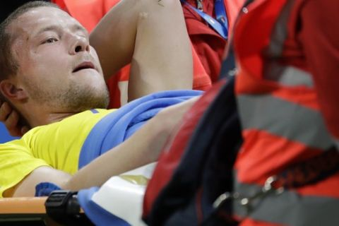 Sweden's Ludwig Augustinsson is carried off the pitch after sustaining an injury during the World Cup qualifying play-off second leg soccer match between Italy and Sweden, at the Milan San Siro stadium, Italy, Monday, Nov. 13, 2017. (AP Photo/Luca Bruno)