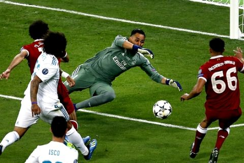 Real Madrid's goalkeeper Keylor Navas, center, saves a shot of Liverpool's Trent Alexander-Arnold, left, during the Champions League Final soccer match between Real Madrid and Liverpool at the Olimpiyskiy Stadium in Kiev, Ukraine, Saturday, May 26, 2018. (AP Photo/Darko Vojinovic)