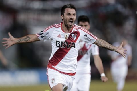 In this July 4, 2017 photo, striker Ignacio Scocco of Argentina's River Plate celebrates after scoring during a Copa Libertadores soccer game against Paraguay's Guarani in Asuncion, Paraguay. (AP Photo/Jorge Saenz)