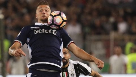 Lazio's Sergej Milinkovic-Savic goes for the ball ahead of Juventus' Tomas Rincon during the Italian Cup soccer final match between Lazio and Juventus, at Rome's Olympic stadium, Wednesday, May 17, 2017. (AP Photo/Gregorio Borgia)