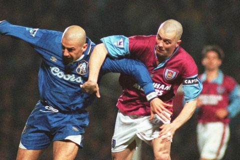 West Ham's Julian Dicks, right, impedes Chelsea's Gianluca Vialli's progress towards the goal in second half action of the Chelsea West Ham Premeir League game at Upton Park in London Wednesday March 12, 1997.  West Ham defeated Chelsea 3-2.  (AP Photo/Jacqueline Arzt)