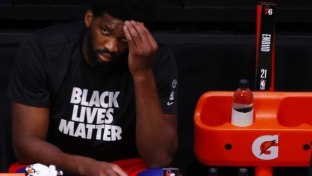 Philadelphia 76ers' Joel Embiid looks on from the bench after being injured earlier in an NBA basketball game against the Portland Trail Blazers during the third quarter of an NBA basketball game Sunday, Aug. 9, 2020, in Lake Buena Vista, Fla. (Kevin C. Cox/Pool Photo via AP)