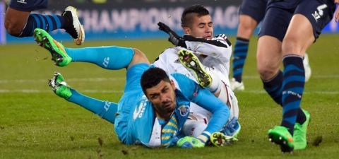 Basel's Paraguayan midfielder Derlis Gonzalez (Rear) scores the opening goal past Porto's Brazilian goalkeeper Fabiano during the UEFA Champions League round of 16 first leg football match between Basel (FCB) and Porto (FCP) on February 18, 2015 at the St. Jakob-Park stadium in Basel.  AFP PHOTO / FABRICE COFFRINI        (Photo credit should read FABRICE COFFRINI/AFP/Getty Images)