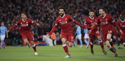 Liverpool's Mohamed Salah, center, celebrates scoring his side's first goal of the game during the Champions League quarter final first leg soccer match between Liverpool and Manchester City at Anfield stadium in Liverpool, England, Wednesday, April 4, 2018. (Peter Byrne/PA via AP)