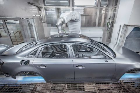 Protecting the environment and cutting costs: With overspray-free painting, Audi is now able to apply two different colors in the same painting process. A robot-controlled high-precision instrument measures the laser-brazed seam between the cars roof and side panel frame. An applicator then applies a black paint specially developed for this method onto the body in strips, with millimeter precision but without spray mist.