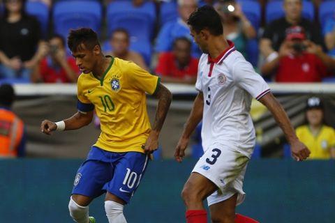 Brazil's Neymar (10) in action against Costa Rica's Giancarlo Gonzalez (3) in an international friendly soccer match in Harrison N.J., Saturday, Sept. 5, 2015. Brazil defeated Costa Rica 1-0. (AP Photo/Rich Schultz)