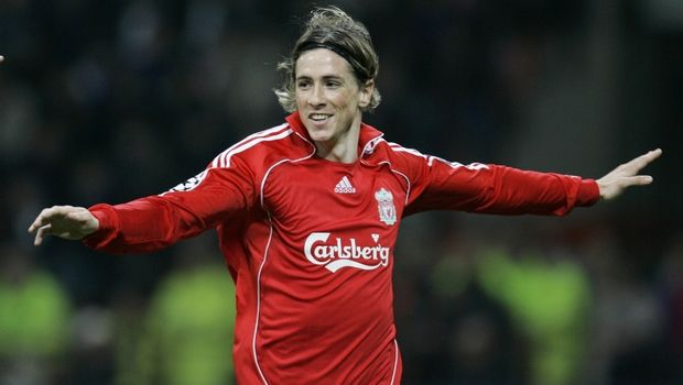 Liverpool forward Fernando Torres, of Spain, cheers after scoring, during a Champions League, round of 16 return-leg soccer match between Inter Milan and Liverpool, at the San Siro stadium in Milan, Italy, Tuesday, March 11, 2008.  (AP Photo/Antonio Calanni)