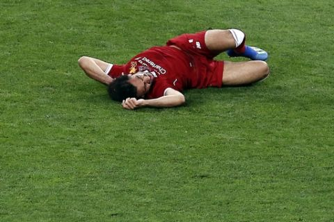 Liverpool's Mohamed Salah lies on the pitch after a collision with Real Madrid's Sergio Ramos during the Champions League Final soccer match between Real Madrid and Liverpool at the Olimpiyskiy Stadium in Kiev, Ukraine, Saturday, May 26, 2018. (AP Photo/Darko Vojinovic)