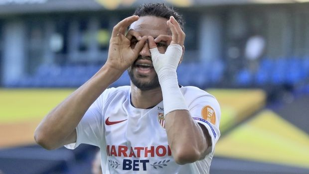 Sevilla's Youssef En-Nesyri celebrates after scoring his side's 2nd goal during the Europa League, round of 16 soccer match between Roma and Sevilla, at the Schauinsland-Reisen-Arena in Duisburg, Germany, Thursday, Aug. 6, 2020. (Wolfgang Rattay/Pool Photo via AP)