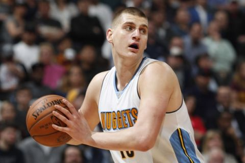 Denver Nuggets forward Nikola Jokic (15) in the second half of an NBA basketball game Wednesday, March 22, 2017, in Denver. The Nuggets won 126-113. (AP Photo/David Zalubowski)