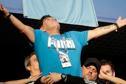 Argentina former soccer star Diego Maradona waves to the fans ahead of the group D match between Argentina and Nigeria, at the 2018 soccer World Cup in the St. Petersburg Stadium in St. Petersburg, Russia, Tuesday, June 26, 2018. (AP Photo/Petr David Josek)
