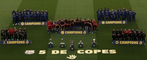 Barcelona's hockey, basketball, football, futsal and handball champions pose for a group picture behind their trophies prior of the Spanish La Liga soccer match between FC Barcelona and Villarreal at the Camp Nou stadium in Barcelona, Spain, Wednesday, May 9, 2018. (AP Photo/Manu Fernandez)