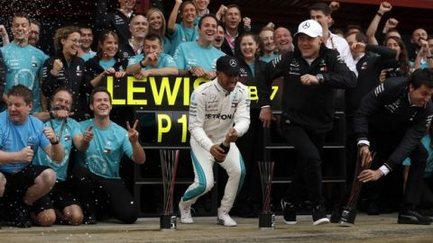 Mercedes driver Lewis Hamilton, of Britain, center, celebrates with his team after winning the Spanish Formula One Grand Prix at the Barcelona Catalunya racetrack in Montmelo, Spain, Sunday, May 13, 2018. (AP Photo/Manu Fernandez)
