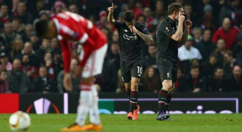 """""""MANCHESTER, ENGLAND - MARCH 17:  Philippe Coutinho of Liverpool (10) celebrates with team mate James Milner (R) as he scores their first goal during the UEFA Europa League round of 16, second leg match between Manchester United and Liverpool at Old Trafford on March 17, 2016 in Manchester, England.  (Photo by Clive Brunskill/Getty Images)"""""""