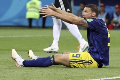 Sweden's Marcus Berg reacts after missing a chance to score during the group F match between Germany and Sweden at the 2018 soccer World Cup in the Fisht Stadium in Sochi, Russia, Saturday, June 23, 2018. (AP Photo/Thanassis Stavrakis)