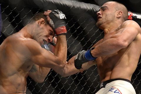 LAS VEGAS, NV - JULY 07:   (R-L) Eddie Alvarez punches Rafael Dos Anjos of Brazil in their lightweight championship bout during the UFC Fight Night event inside the MGM Grand Garden Arena on July 7, 2016 in Las Vegas, Nevada. (Photo by Brandon Magnus/Zuffa LLC/Zuffa LLC via Getty Images)