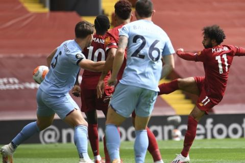 during the English Premier League soccer match between Liverpool and Burnley at Anfield in Liverpool, England, Saturday , July 11, 2020. (Phil Noble/Pool via AP)