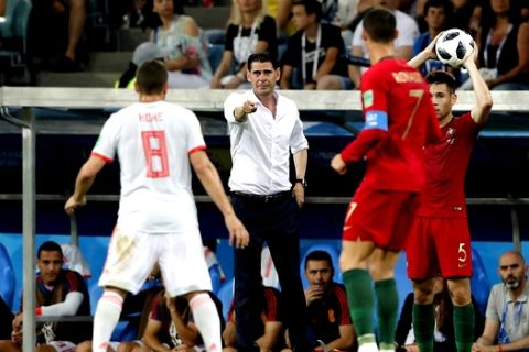 Spain head coach Fernando Hierro reacts during the group B match between Portugal and Spain at the 2018 soccer World Cup in the Fisht Stadium in Sochi, Russia, Friday, June 15, 2018. (AP Photo/Frank Augstein)