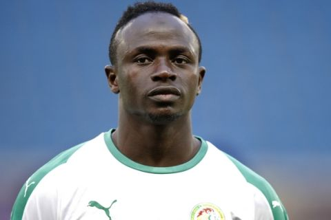 Senegal's Sadio Mane listens to national anthem prior to a friendly soccer match between Senegal and Bosnia and Herzegovina at the Oceane stadium in Le Havre, northern France, Tuesday, March 27, 2018. (AP Photo/Francois Mori)