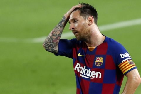 Barcelona's Lionel Messi reacts after the end of a Spanish La Liga soccer match between Barcelona and Osasuna at the Camp Nou stadium in Barcelona, Spain, Thursday, July 16, 2020. (AP Photo/Joan Monfort)