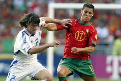 epa000226578 Portugal's Cristiano Ronaldo(R) fights for the ball with Greek Giourkas Seitaridis during  the EURO 2004 Final between  Portugal and Greece at Luz stadium in Lisbon on Sunday 04 July 2004.  EPA/PAULO CARRICO NO MOBIL APPLICATIONS