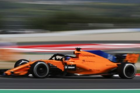 Mclaren driver Fernando Alonso of Spain steers his car during a free practice at the Barcelona Catalunya racetrack in Montmelo, just outside Barcelona, Spain, Friday, May 11, 2018. The Formula One race will take place on Sunday. (AP Photo/Manu Fernandez)