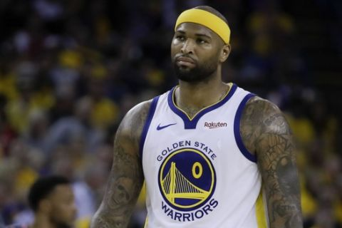 Golden State Warriors center DeMarcus Cousins (0) walks on the court during the first half of Game 3 of basketball's NBA Finals between the Warriors and the Toronto Raptors in Oakland, Calif., Wednesday, June 5, 2019. (AP Photo/Ben Margot)