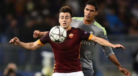Roma's forward from Italy Stephan El Shaarawy (front) vies with Real Madrid's French defender Raphael Varane during the UEFA Champions League football match AS Roma vs Real Madrid on Frebruary 17, 2016 at the Olympic stadium in Rome.   AFP PHOTO / FILIPPO MONTEFORTE / AFP / FILIPPO MONTEFORTE        (Photo credit should read FILIPPO MONTEFORTE/AFP/Getty Images)