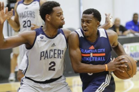 Oklahoma City Thunder's Semaj Christon, right, attempts to drive around Indiana Pacers' Jordan Loyd (2) during the first half of an NBA summer league basketball game, Thursday, July 6, 2017, in Orlando, Fla. (AP Photo/John Raoux)