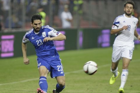 Bosnia's Sanjin Prcic, right, and Marios Nikolaou of Cyprus challenge for the ball during the Euro 2016 qualifying soccer match between Bosnia and Cyprus at Stadium Bilino Polje in Zenica, Bosnia, on Tuesday, Sept. 9, 2014. (AP Photo/Amel Emric)