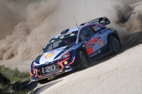 Thierry Neuville doubled his lead at Vodafone Rally de Portugal on May 19, boosting his title hopes. The Belgian starts tomorrow's short finale with a 39.8sec advantage in his Hyundai i20, and victory would propel him back to the head of the FIA World Rally Championship for the first time since February. He distanced closest rival Elfyn Evans to build a comfortable advantage but Evans won two of the day's six stages in his Ford Fiesta to look increasingly secure in second as the day progressed. Evans has a 17.4sec margin to Dani Sordo in third. // Thierry Neuville (BEL, stage leader) performs during the FIA World Rally Championship 2018 in Porto, Portugal on May 19, 2018 // Jaanus Ree/Red Bull Content Pool via AP Images  // For more content, pictures and videos like this please go to http://www.redbullcontentpool.com