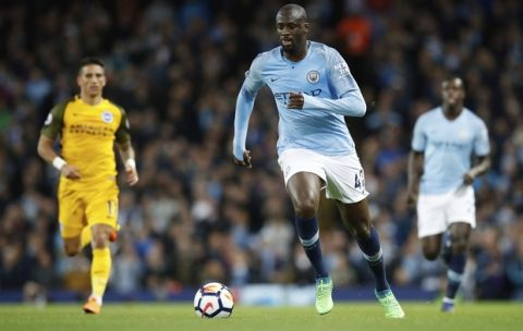 Manchester City's Yaya Toure controls the ball during the English Premier League soccer match against Brighton & Hove Albion at the Etihad Stadium, Manchester, England, Wednesday May 9, 2018. (Martin Rickett/PA via AP)