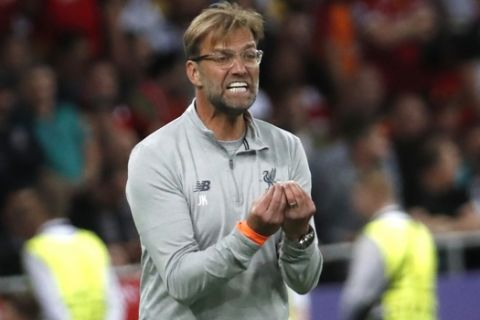 Liverpool coach Jurgen Klopp gestures during the Champions League Final soccer match between Real Madrid and Liverpool at the Olimpiyskiy Stadium in Kiev, Ukraine, Saturday, May 26, 2018. (AP Photo/Pavel Golovkin)